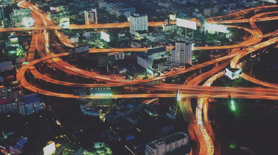 Birds eye view of metropolitan city and its highway system at night